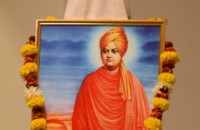 Student paying floral tributes to the portrait of Swami Vivekanand.